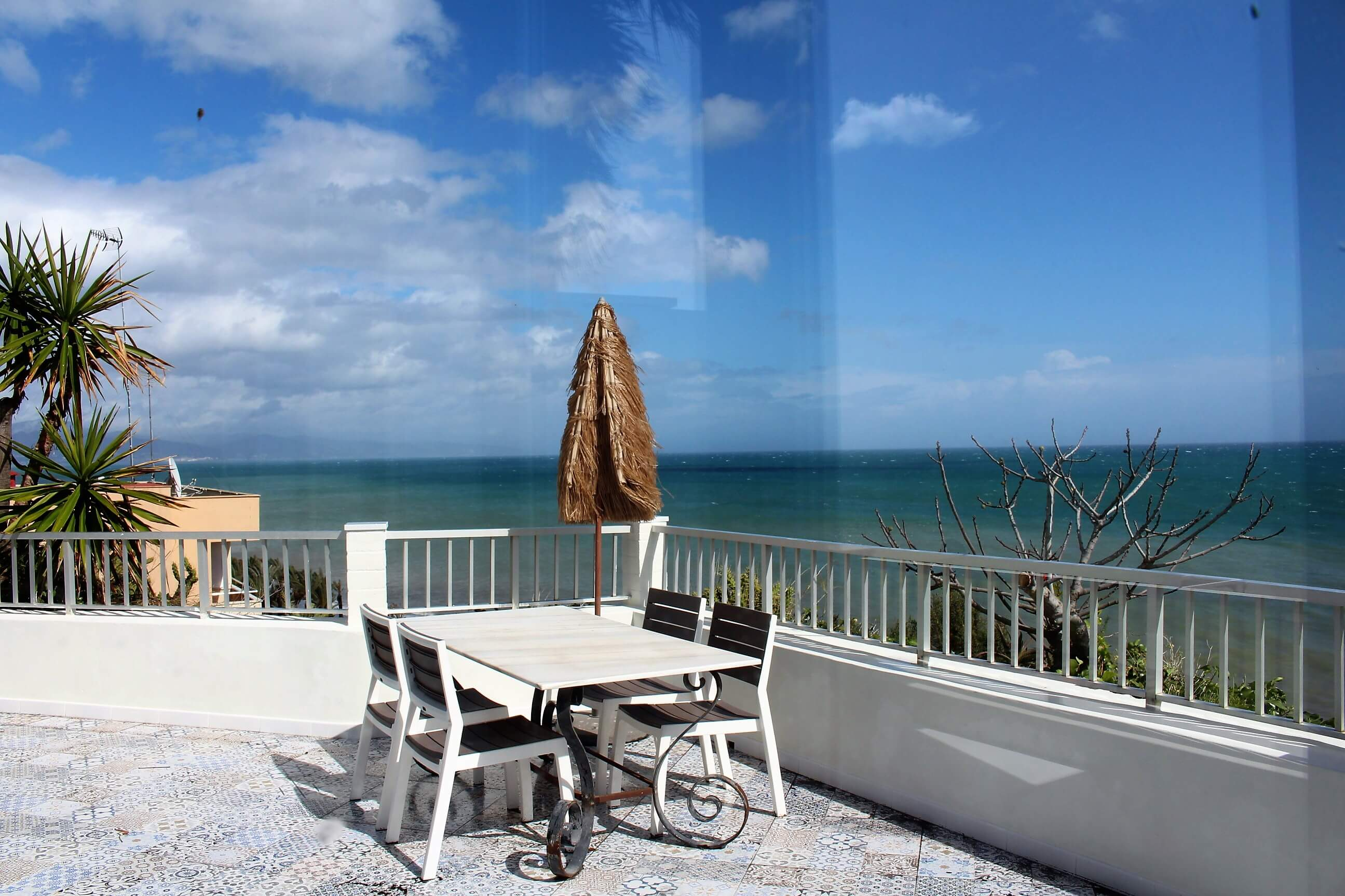 Spectacular Beach House Bungalow overlooking the beach and Malaga bay.